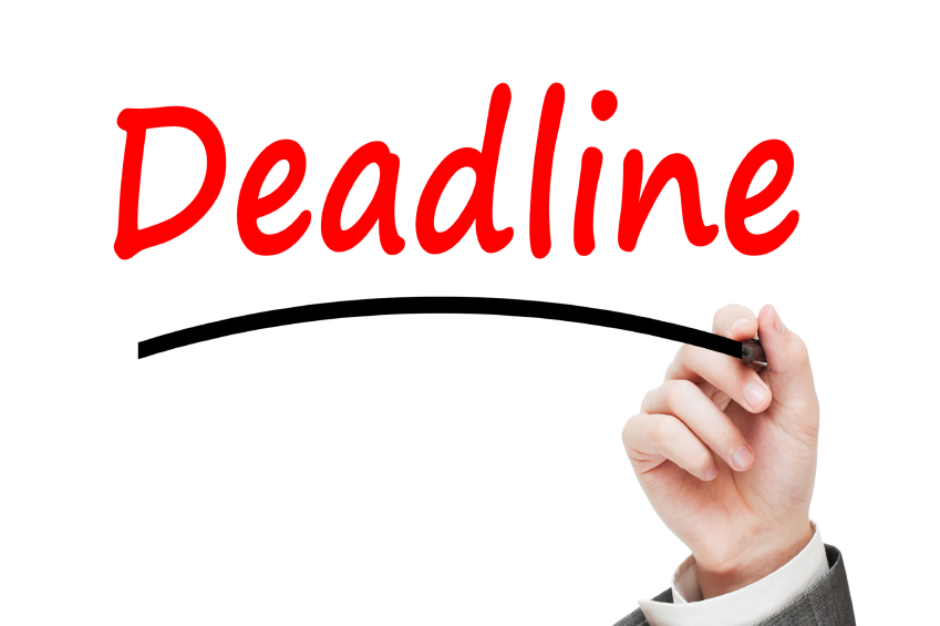 Man writing Deadline Concept with red marker isolated on white b